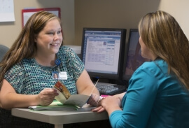Care Coordinator Aaryn Ackley helps a patient
